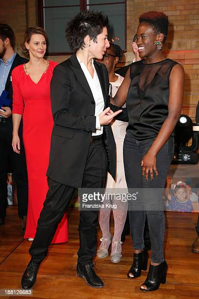 Dunja Hayali and Ivy Quainoo attend the 15th Media Award By Kindernothilfe at Hauptstadtrepraesentanz Deutsche Telekom AG on November 15 2013 in...