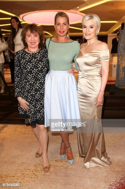 Dunja Siegel and her daughter Giulia Siegel Kriemhild Siegel wearing a dress by Christina Duxa and jewelry by Juwelenschmiede during the Lovely...