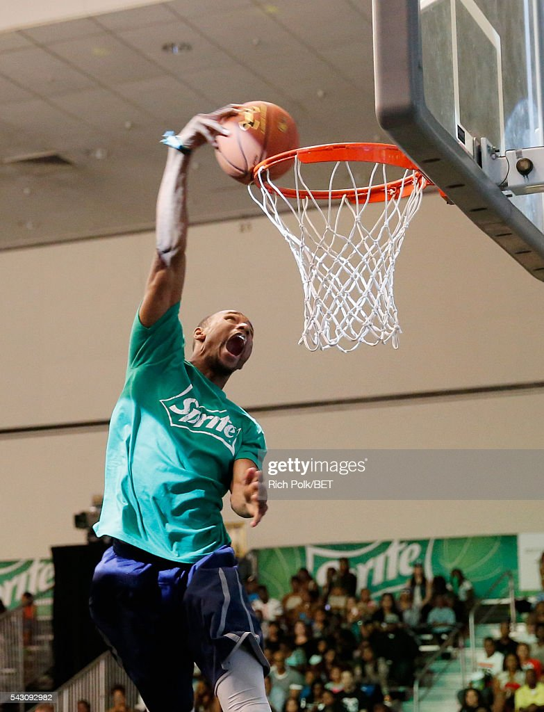 Dunk artist Christon Staples participates in the slam dunk contest during the 2016 BET Experience on June 25, 2016 in Los Angeles, California.
