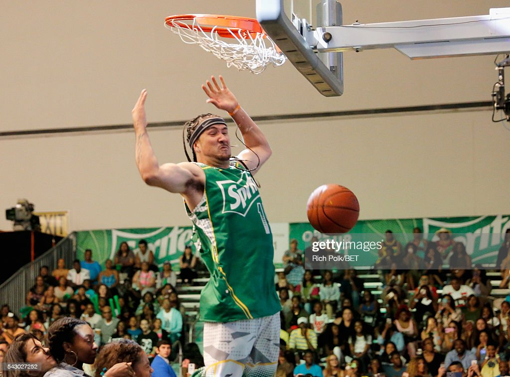 Dunk artist Kenny Dobbs participates in the slam dunk contest during the 2016 BET Experience on June 25, 2016 in Los Angeles, California.