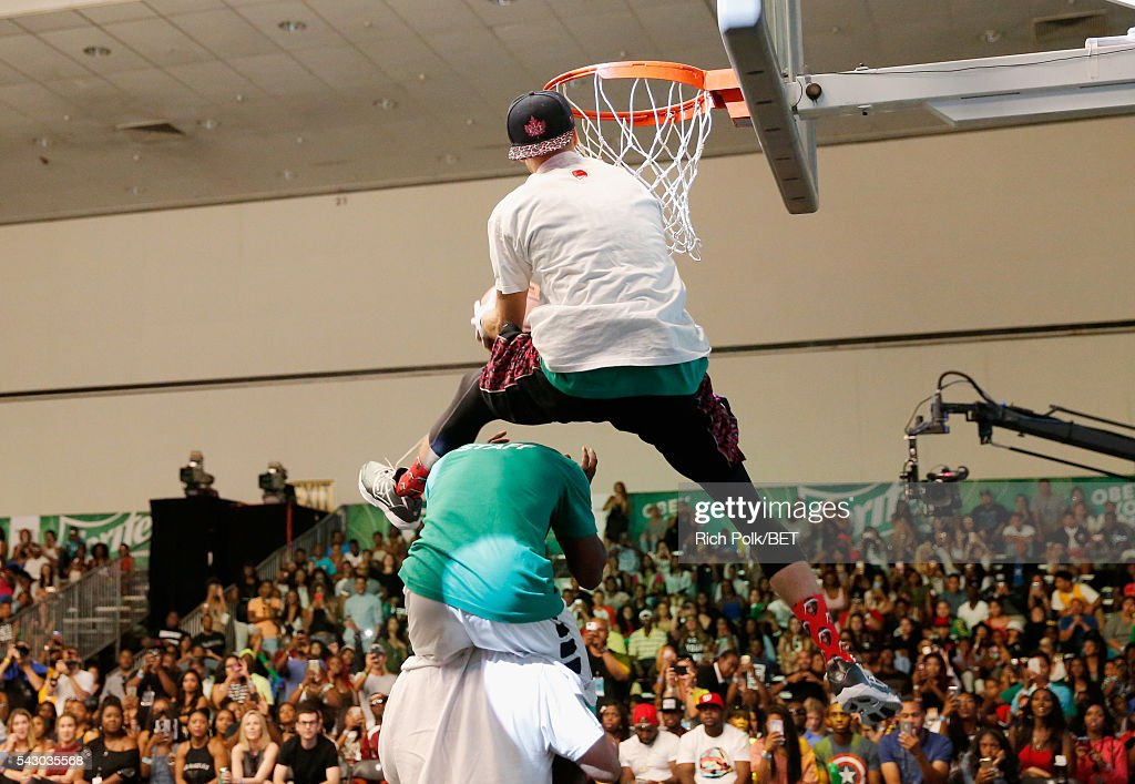 Dunk artist Rafal 'Lipek' Lipinski participates in the slam dunk contest during the 2016 BET Experience on June 25, 2016 in Los Angeles, California.
