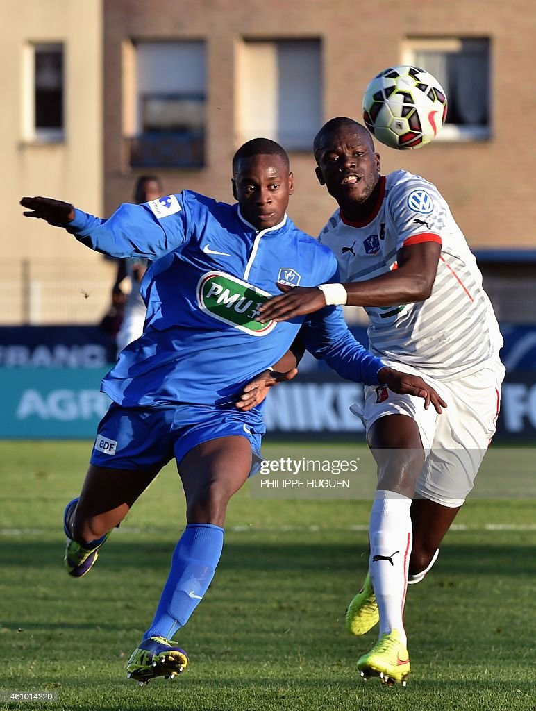 Dunkerque forward Hamady Tamboura (L) vies with Rennes' French midfielder Fallou Diagne during the French Cup football match Dunkerque vs Rennes on January 4, 2015 at the ' Marcel Tribut' stadium in Dunkerque, northern France.
