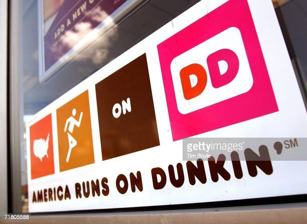 Dunkin' Donuts hangs on a window September 7 2006 in Chicago Illinois In an effort to compete with Starbucks in the lucrative coffee market Dunkin...