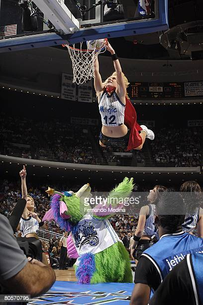 A dunking dancer of the Orlando Magic goes up for the shot during the game against the Philadelphia 76ers at the Amway Arena on February 22 2008 in...