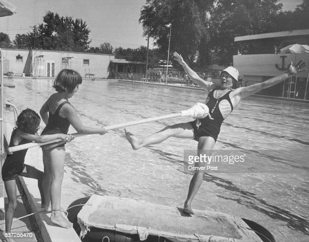 Dunking Lifeguards is Great Sport Joanne Tanaka left of 3085 Wilson Court and Mary Haley of 3635 Monaco Parkway practice dunking Bruce Bryan a...