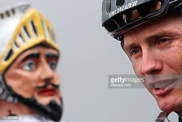 Belgiums Johan Vansummeren stands by a huge wicker model called Dunkirk's Giant before the start of the second stage of the 94th Tour de France...