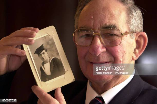 Dunkirk veteran Albert 'Joe' Barnes with a photograph of himself as an 18yearold able seaman The 75yearold former bus driver received a medal at the...