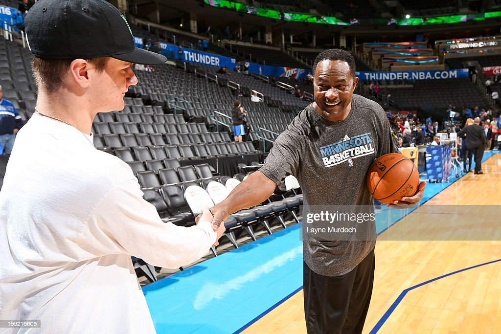 T.R. Dunn, assistant coach for the Minnesota Timberwolves, right, greets Cody Metz, in attendance through the Make-A-Wish Foundation, before a game between the Timberwolves and Oklahoma City Thunder on January 9, 2013 at the Chesapeake Energy Arena in Oklahoma City, Oklahoma.