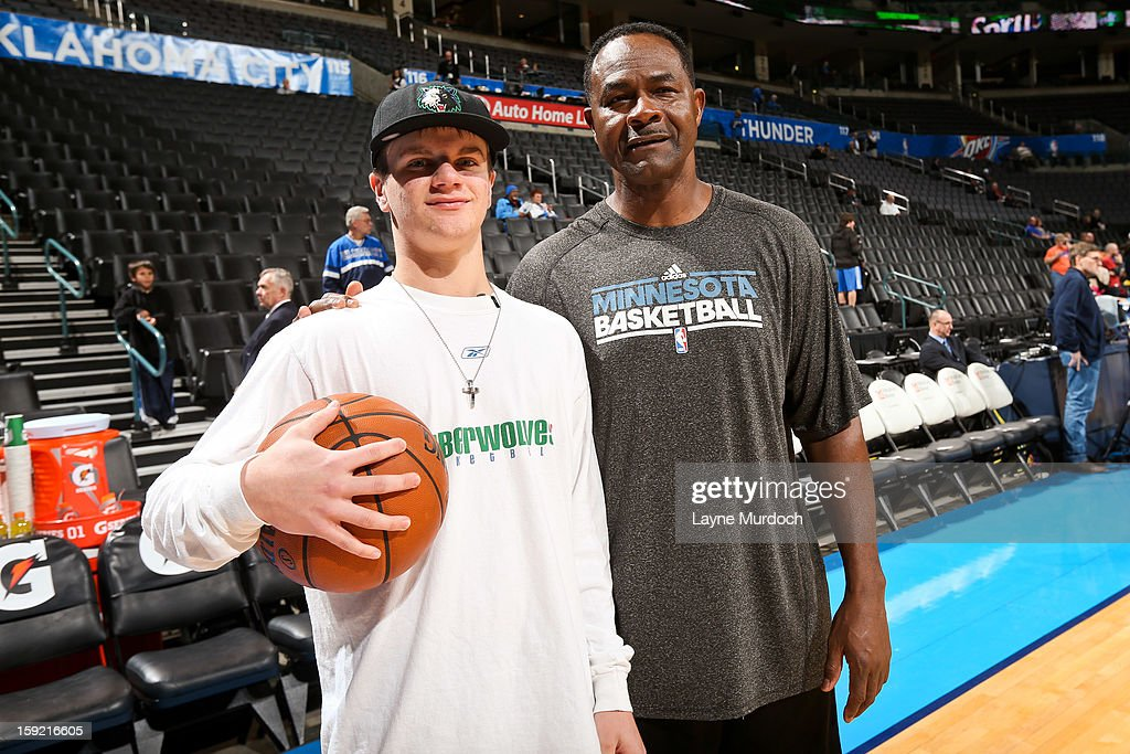 T.R. Dunn, assistant coach for the Minnesota Timberwolves, right, poses with Cody Metz, in attendance through the Make-A-Wish Foundation, before a game between the Timberwolves and Oklahoma City Thunder on January 9, 2013 at the Chesapeake Energy Arena in Oklahoma City, Oklahoma.