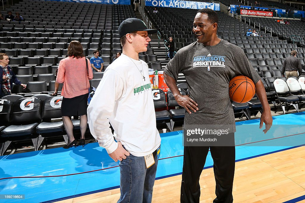 T.R. Dunn, assistant coach for the Minnesota Timberwolves, right, speaks with Cody Metz, in attendance through the Make-A-Wish Foundation, before a game between the Timberwolves and Oklahoma City Thunder on January 9, 2013 at the Chesapeake Energy Arena in Oklahoma City, Oklahoma.