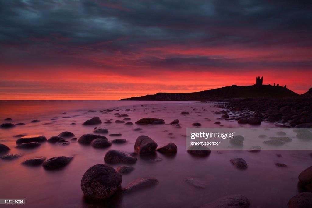 Dunstanburgh Castle at Dawn. : Stock Photo