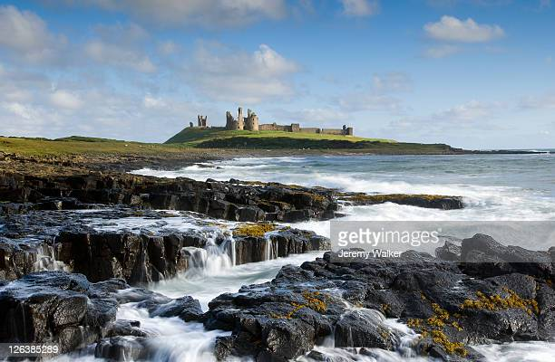 Dunstanburgh Castle, standing on a rocky clifftop, dominates a lonely stretch of Northumberland's coastline, and was once one of the largest and grandest fortifications in northern England.