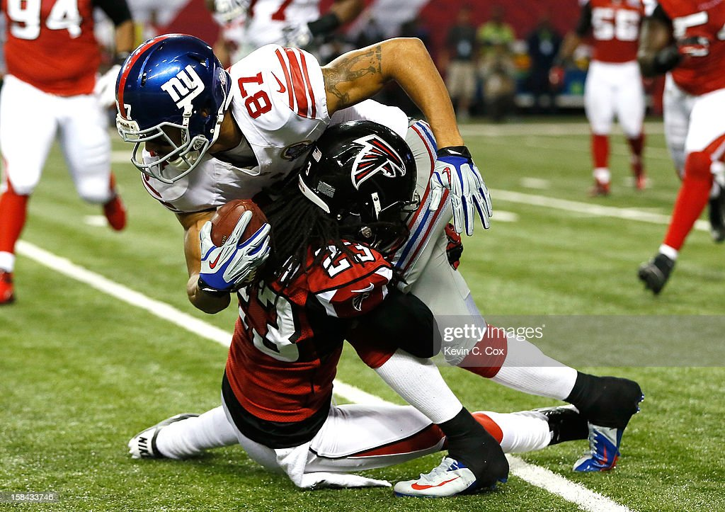 <a gi-track='captionPersonalityLinkClicked' href=/galleries/search?phrase=Dunta+Robinson&family=editorial&specificpeople=182498 ng-click='$event.stopPropagation()'>Dunta Robinson</a> #23 of the Atlanta Falcons tries to tackle <a gi-track='captionPersonalityLinkClicked' href=/galleries/search?phrase=Domenik+Hixon&family=editorial&specificpeople=736537 ng-click='$event.stopPropagation()'>Domenik Hixon</a> #87 of the New York Giants at Georgia Dome on December 16, 2012 in Atlanta, Georgia.