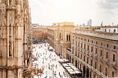 Top view on Duomo square with people walking in the center of Milan