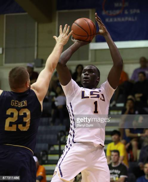 Duop Reath of the LSU Tigers shoots over Martinas Geben of the Notre Dame Fighting Irish during the second half of their game during the Maui...