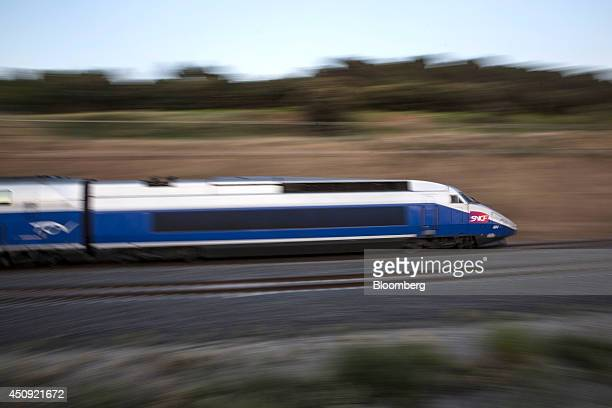 A TGV duplex highspeed train operated by Societe Nationale des Chemins de Fer and manufactured by Alstom SA heads towards the city of Avignon and the...