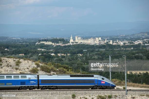 A TGV duplex highspeed train operated by Societe Nationale des Chemins de Fer and manufactured by Alstom SA passes the city of Avignon as it arrives...