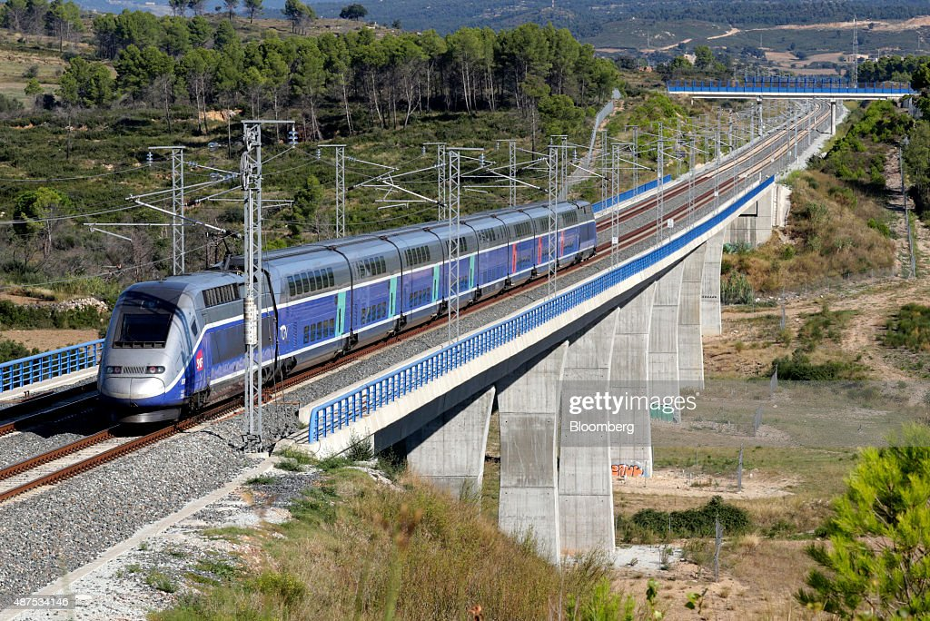 A TGV duplex highspeed train operated by Societe Nationale des Chemins de Fer passes by the Llobregat river viaduct in Llers Spain on Wednesday Sept...