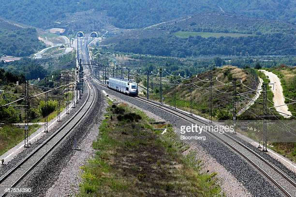 A TGV duplex highspeed train operated by Societe Nationale des Chemins de Fer heads northbound from the Perthus Tunnel in Perthus France on Wednesday...