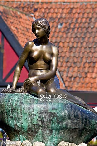 A duplicate of the statue the Little Mermaid Tivoli Gardens Copenhagen Denmark