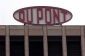DuPont sign is shown at the company's world headquarters April 12 2004 in Wilmington Delaware The Wilmington based chemical manufacturer plans to...