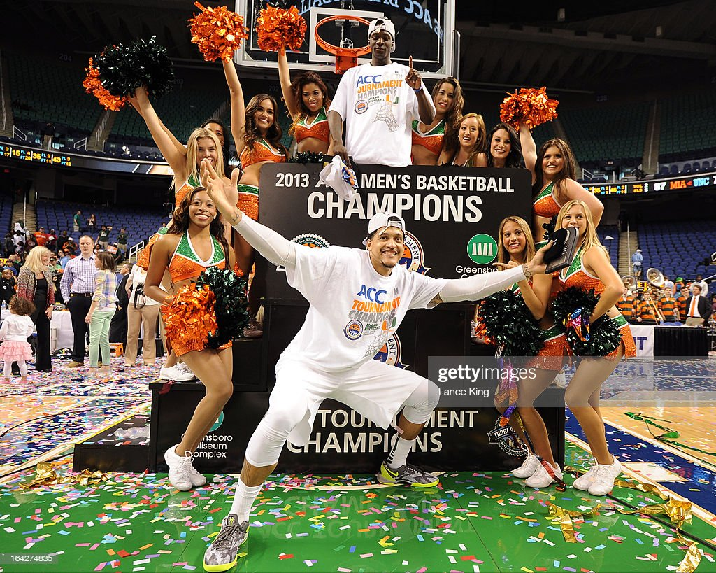 Durand Scott (top) #1 and Julian Gamble #45 celebrate with cheerleaders of the Miami Hurricanes following their 88-77 victory against the North Carolina Tar Heels during the finals of the 2013 Men's ACC Tournament at the Greensboro Coliseum on March 17, 2013 in Greensboro, North Carolina.