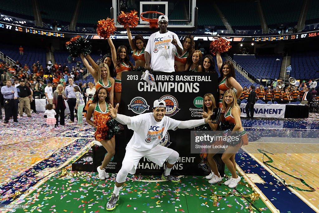 Durand Scott #1 and Julian Gamble #45 (bottom) of the Miami (Fl) Hurricanes celebrates with Miami cheerleaders after they won 87-77 against the North Carolina Tar Heels during the final of the Men's ACC Basketball Tournament at Greensboro Coliseum on March 17, 2013 in Greensboro, North Carolina.