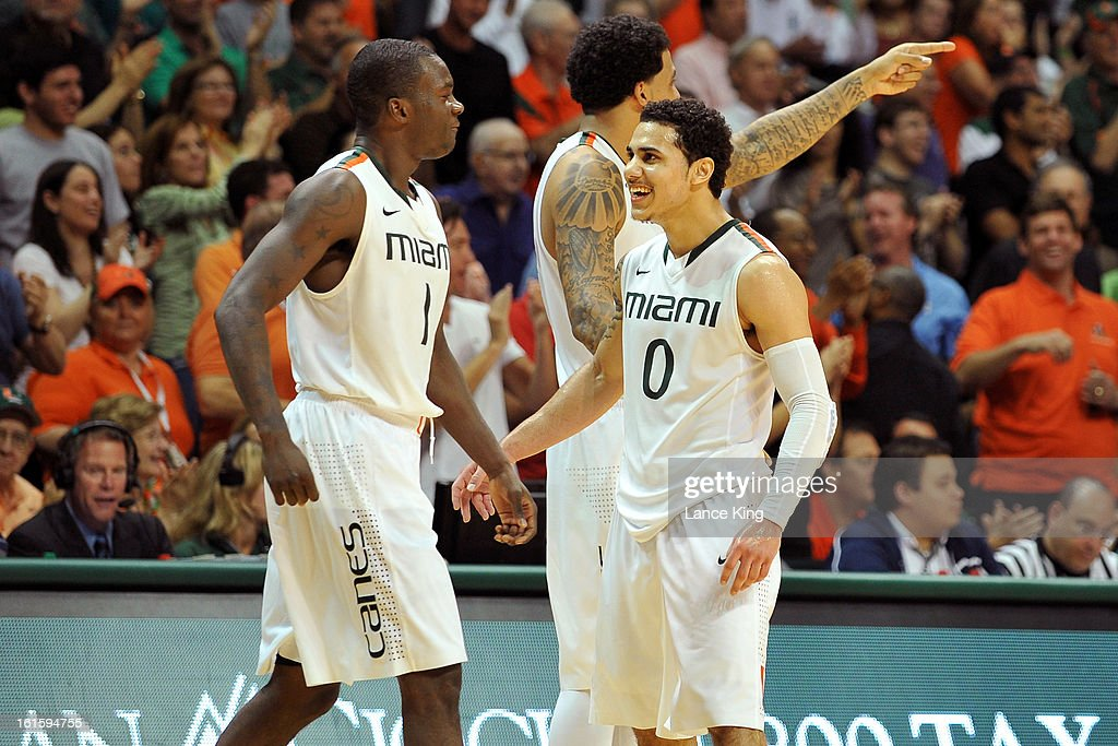 Durand Scott #1 and Shane Larkin #0 of the Miami Hurricanes celebrate following a play against the North Carolina Tar Heels at the BankUnited Center on February 9, 2013 in Coral Gables, Florida. Miami defeated North Carolina 87-61.