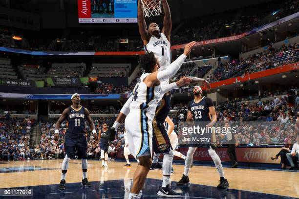Durand Scott of the Memphis Grizzlies dunks the ball during a preseason game against the New Orleans Pelicans on October 13 2017 at FedExForum in...