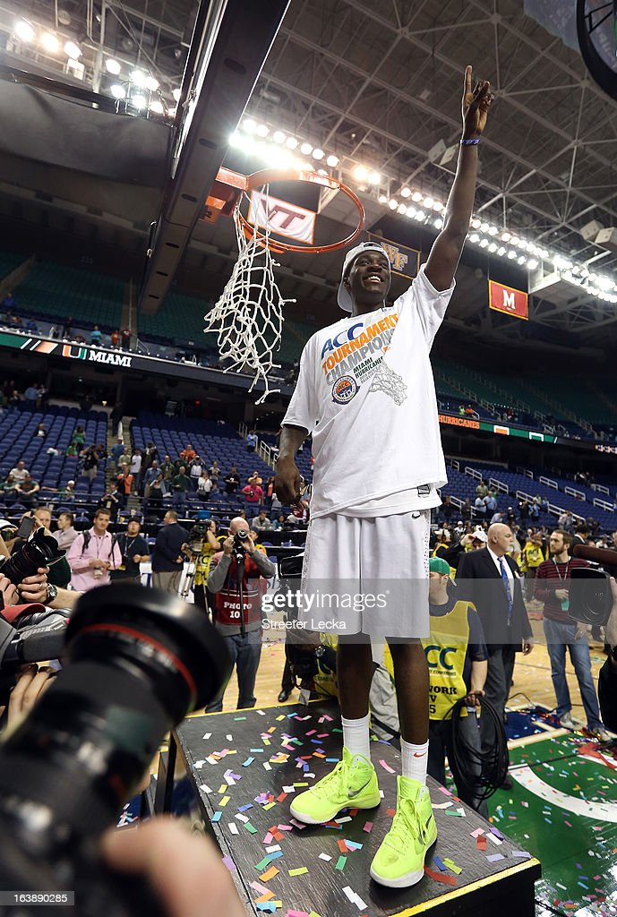 Durand Scott #1 of the Miami (Fl) Hurricanes celebrates after he cut down a piece of the net after they won 87-77 against the North Carolina Tar Heels during the final of the Men's ACC Basketball Tournament at Greensboro Coliseum on March 17, 2013 in Greensboro, North Carolina.