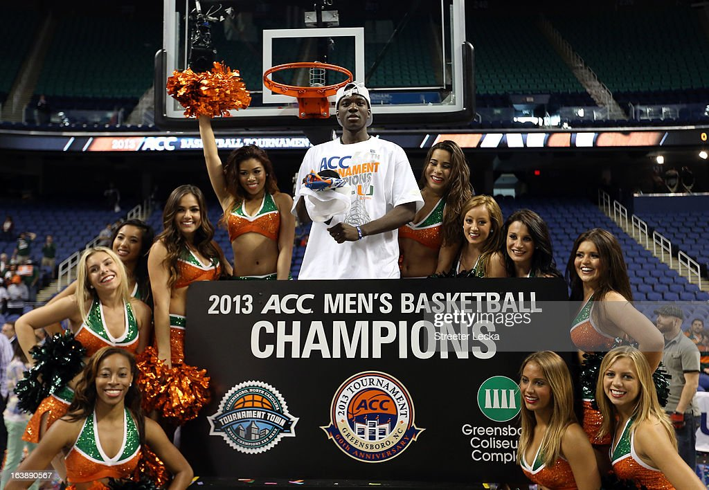 Durand Scott #1 of the Miami (Fl) Hurricanes celebrates with Miami cheerleaders after they won 87-77 against the North Carolina Tar Heels during the final of the Men's ACC Basketball Tournament at Greensboro Coliseum on March 17, 2013 in Greensboro, North Carolina.