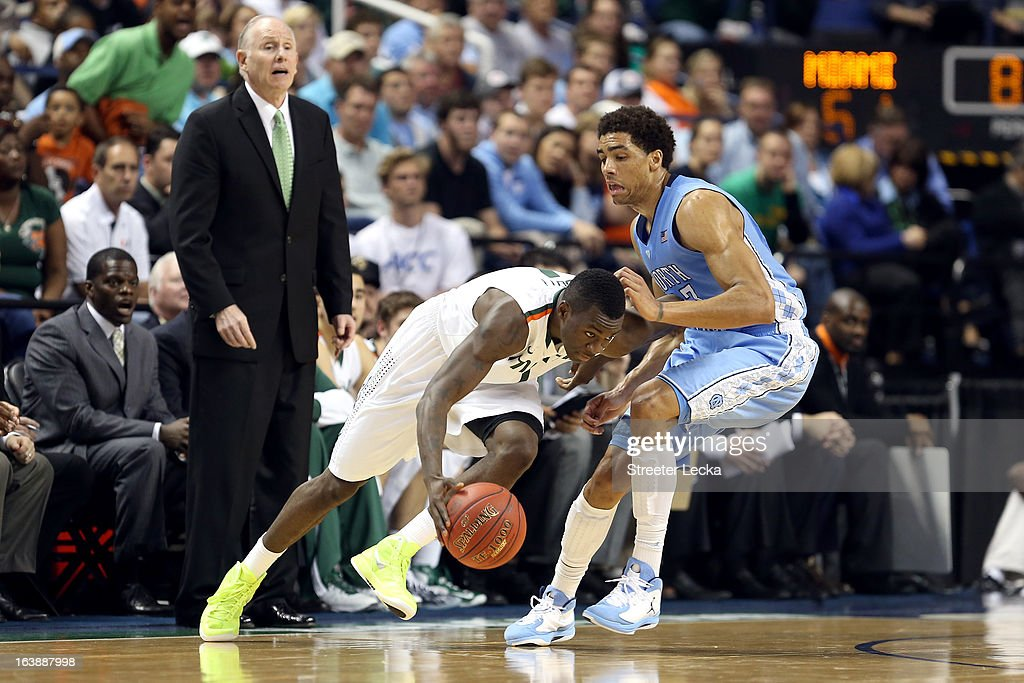 Durand Scott #1 of the Miami (Fl) Hurricanes drives in the second half against James Michael McAdoo #43 of the North Carolina Tar Heels during the final of the Men's ACC Basketball Tournament at Greensboro Coliseum on March 17, 2013 in Greensboro, North Carolina.