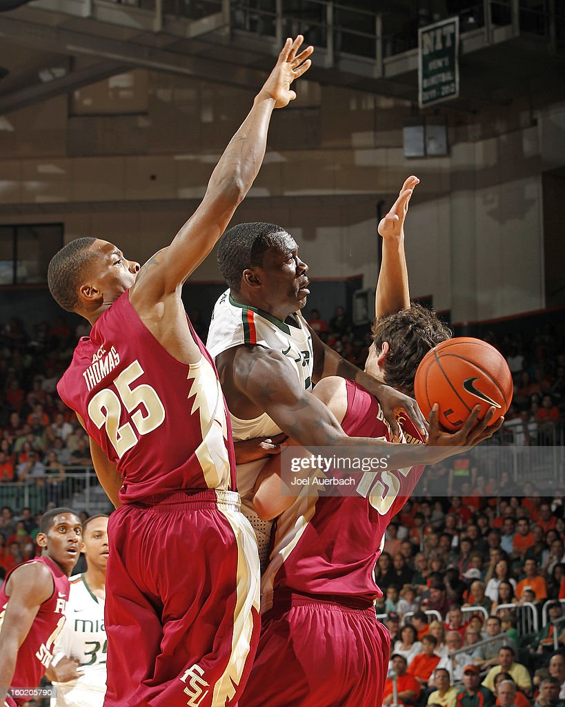 Durand Scott #1 of the Miami Hurricanes gets fouled by Boris Bojanovsky #15 of the Florida State Seminoles as he takes the shot on January 27, 2013 at the BankUnited Center in Coral Gables, Florida.