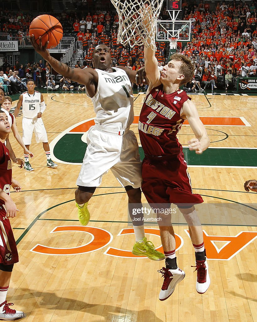 Durand Scott #1 of the Miami Hurricanes goes to the basket against Eddie Odio #4 of the Boston College Eagles on February 5, 2013 at the BankUnited Center in Coral Gables, Florida. The Hurricanes defeated the Eagles 72-50.