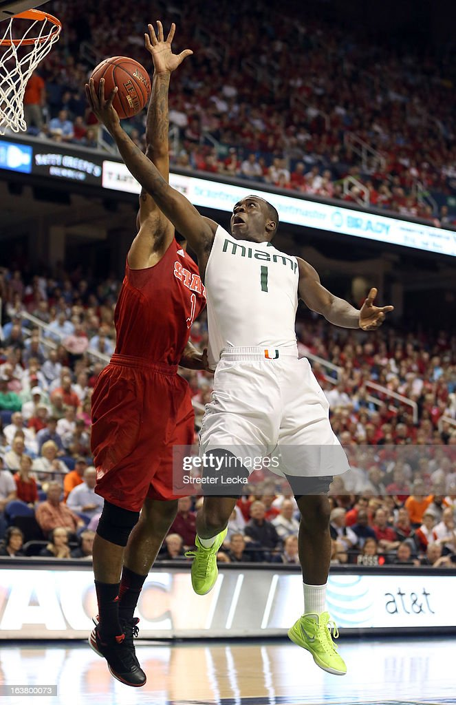 Durand Scott of the Miami Hurricanes goes up for a shot against Richard Howell of the North Carolina State Wolfpack in the first half during the...