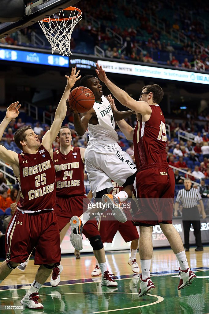 Durand Scott #1 of the Miami Hurricanes handles the ball against Joe Rahon #25 and Andrew Van Nest #15 of the Boston College Eagles during the quarterfinals of the ACC Men's Basketball Tournament at the Greensboro Coliseum on March 15, 2013 in Greensboro, North Carolina.