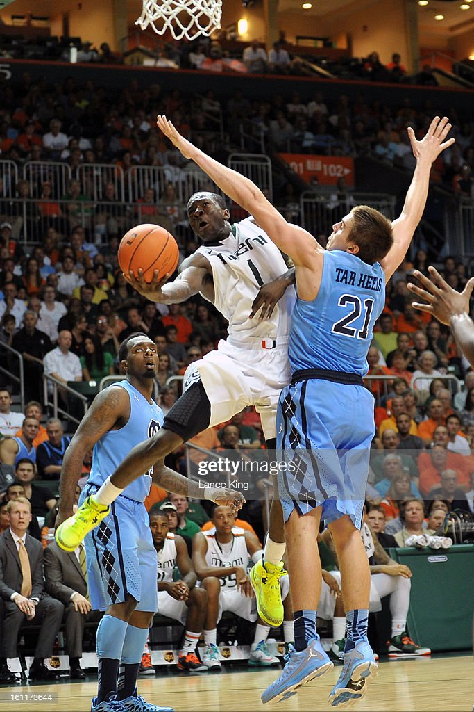 Durand Scott #1 of the Miami Hurricanes puts up a shot against Jackson Simmons #21 of the North Carolina Tar Heels at the BankUnited Center on February 9, 2013 in Coral Gables, Florida. Miami defeated North Carolina 87-61.