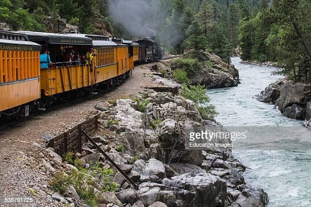 Durango and Silverton Narrow Gauge Railroad Steam Engine travels along Animas River Colorado