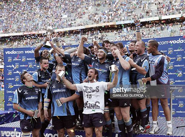 Bulls team celebrates 19 May 200 after winning the Super14 final match against the Sharks at ABSA stadium in Durban South Africa AFP PHOTO/GIANLUIGI...