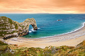 Durdle Door, world famous geological wonder, a natural limestone arch on the Jurassic Coast near Lulworth in Dorset, England.
