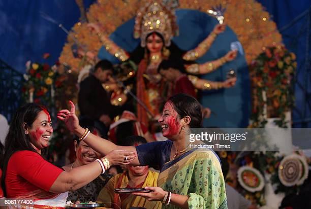 Durga Puja Bengali Women playing traditional sindur before Goddess Durga immersion at Shivaji Park