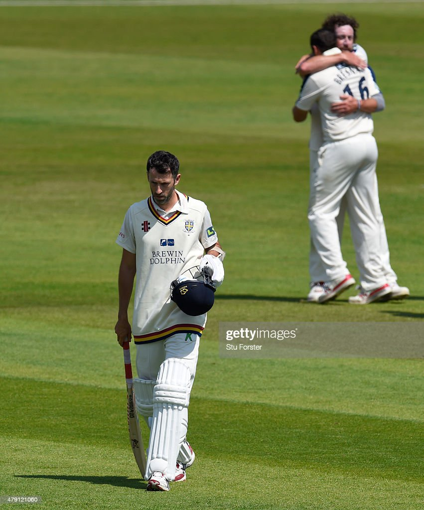 Durham batsman Graham Onions walks off as Yorkshire bowler Ryan Sidebottom and Tim Bresnan celebrate after the final Durham wicket is taken and...