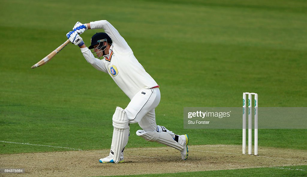 Durham batsman Jack Burnham drives during day one of the Specsavers County Championship Division One match between Durham and Warwickshire at the...