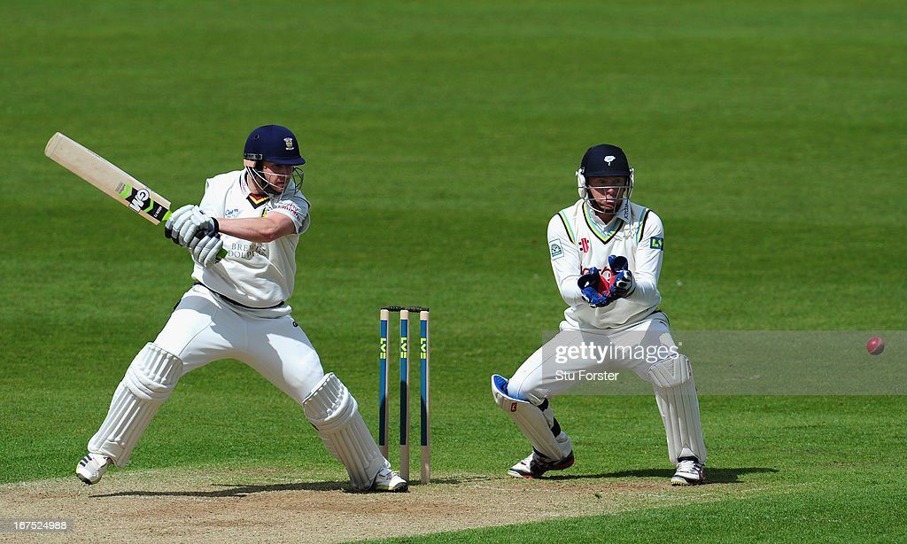 Durham batsman Mark Stoneman cuts a ball to the boundary watched by Yorkshire wicketkeeper <a gi-track='captionPersonalityLinkClicked' href=/galleries/search?phrase=Jonathan+Bairstow&family=editorial&specificpeople=6893210 ng-click='$event.stopPropagation()'>Jonathan Bairstow</a> during day three of the LV County Championship division One match between Durham and Yorkshire at The Riverside on April 26, 2013 in Chester-le-Street, England.