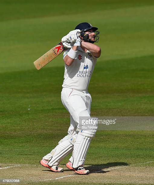 Durham batsman Mark Stoneman drives towards the boundary during day three of the LV County Championship Division One match between Durham and...