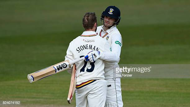 Durham batsman Mark Stoneman is congratulated by Jack Burnham after reaching his century during day two of the Specsavers County Championship...