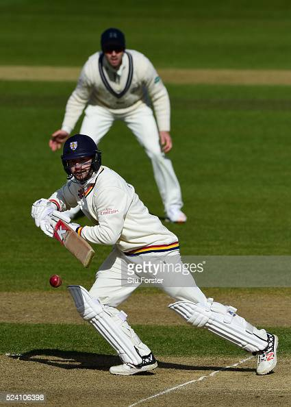 Durham batsman Mark Stoneman picks up some runs during his century watched by Middlesex fielder Nick Compton during day two of the Specsavers County...