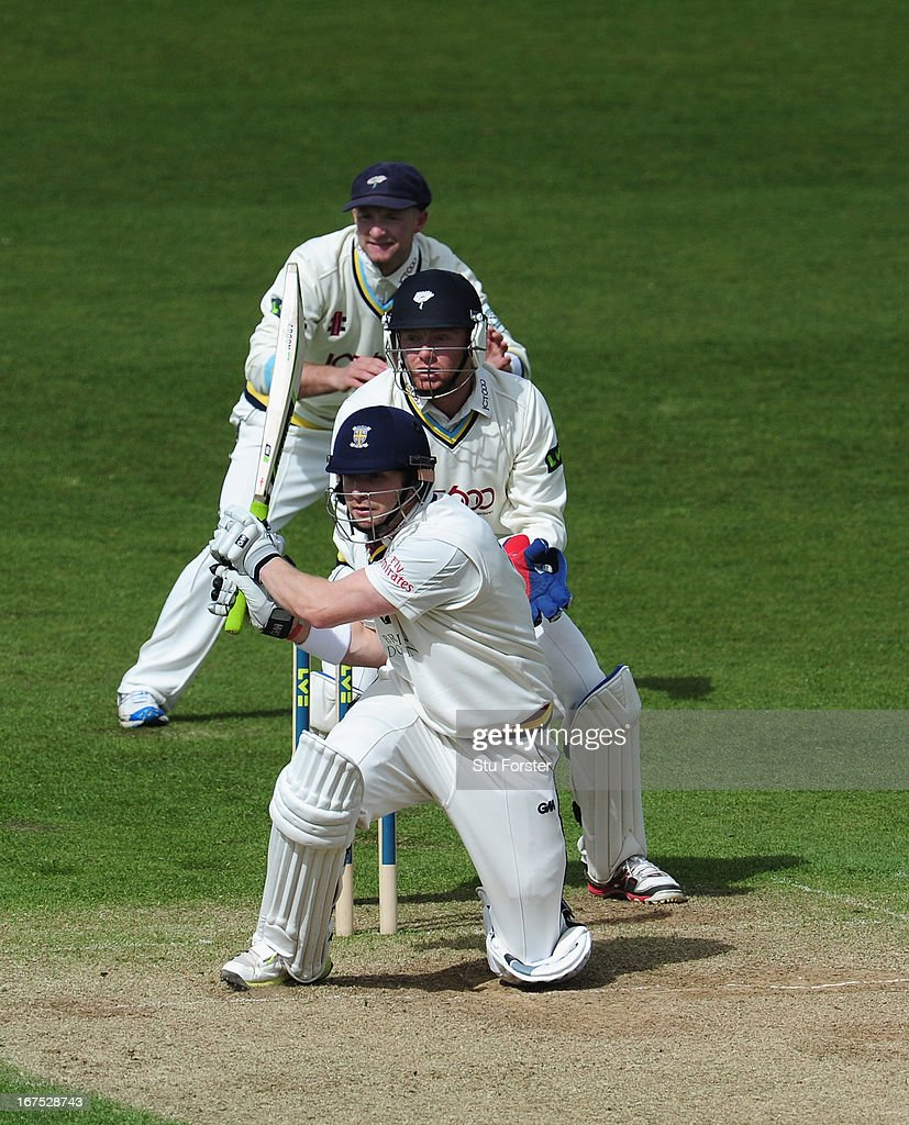 Durham batsman Mark Stoneman pulls a ball to the boundary watched by Yorkshire wicketkeeper <a gi-track='captionPersonalityLinkClicked' href=/galleries/search?phrase=Jonathan+Bairstow&family=editorial&specificpeople=6893210 ng-click='$event.stopPropagation()'>Jonathan Bairstow</a> and slip Adam Lyth during day three of the LV County Championship division One match between Durham and Yorkshire at The Riverside on April 26, 2013 in Chester-le-Street, England.
