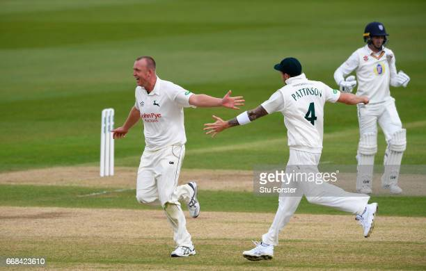Durham batsman Michael Richardson leaves the field after being dismissed by Luke Fletcher who is congratulated by James Pattinson during day one of...