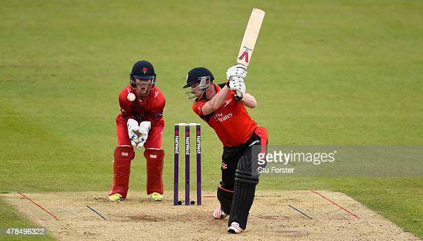 Durham batsman Paul Collingwood hits out watched by Lancashire wicketkeeper Alex Davies during the NatWest T20 blast between Durham Jets and...